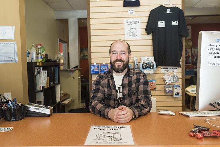 Adam Hirzel, Saki Record store manager, working at Saki Records 3716 W Fullerton Ave. Nov 11