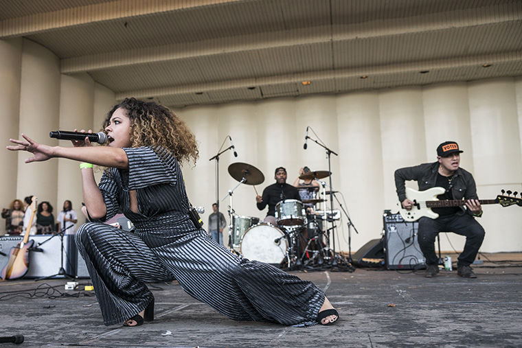 """Chicago-based artist Eryn Allen Kane, whose energetic singing and dancing that elicited excitement from the massive audience, opens the concert accompanied by a band of brass instruments, piano and drums. The evening before Election Day, Chance the Rapper held a free concert Nov. 7 of Chicago-based musicians titled """"Parade to the Polls"""" as a way to encourage millennials to vote. After the concert, which was held in Grant Park, Chance led the hundreds of attendees to a local polling place so they could cast their early vote."""