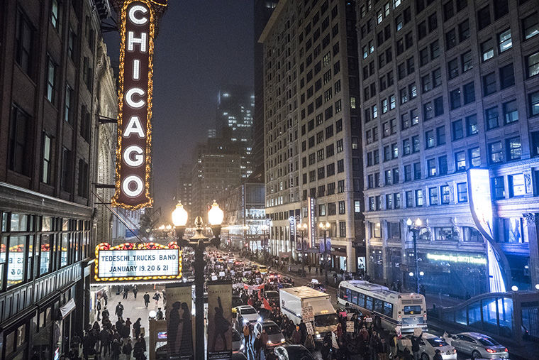Protesters brought traffic to a stop in front of the Chicago Theatre, 175 N. State St., during the Jan. 20 protests of President Donald Trump.