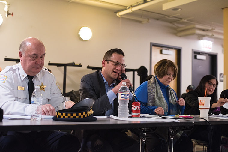 District+12+Cmdr.+Ed+Kulbida+addressed+recent+shootings%2C+one+of+which+occurred+the+afternoon+of+Feb.+3+on+Chicago+Avenue%2C+at+a+Feb.+6+community+meeting.