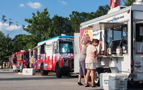 A battle over Chicago's food truck regulations pits the city against libertarian lawyers who critiques the rules as anti-competitive.