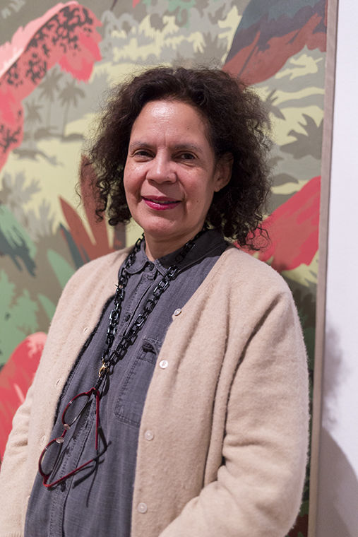 Candida Alvarez poses in front of her painting