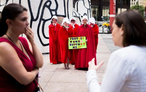 'Handmaids' protesters silently urge Rauner to sign abortion rights bill