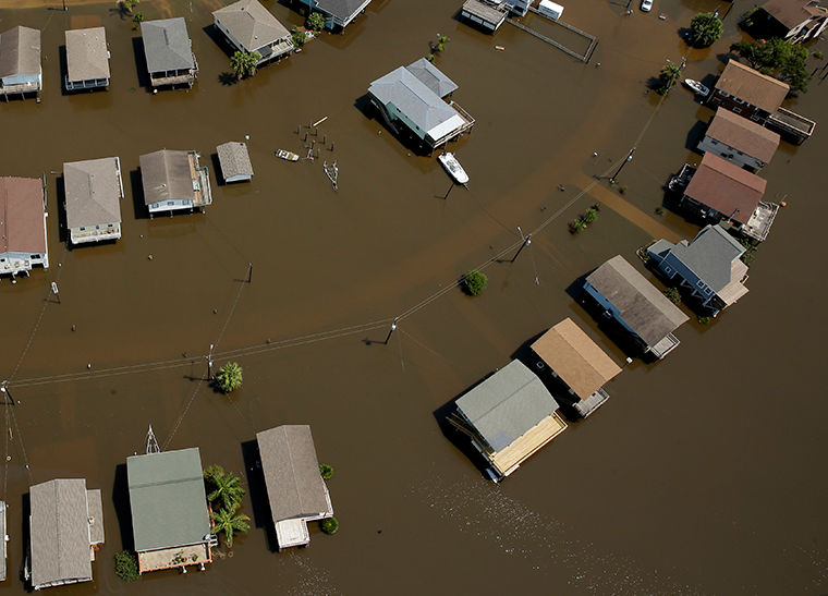 Homes are surrounded by flood water in the aftermath of Hurricane Harvey Sept. 1 near Houston, Texas.