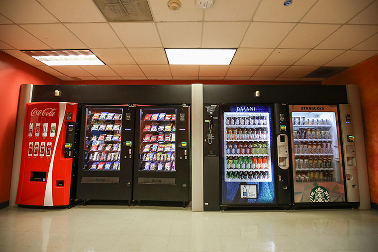 The Mark Vend. Co. vending machines in Columbia buildings have QR codes and a telephone number to send in snack suggestions.