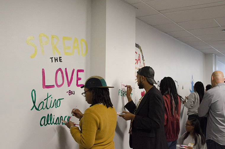 Students and student organization representatives painted messages and images on the new mural wall as a part of the office's unveiling on the fourth floor of 618 S. Michigan Ave. Sept. 7.
