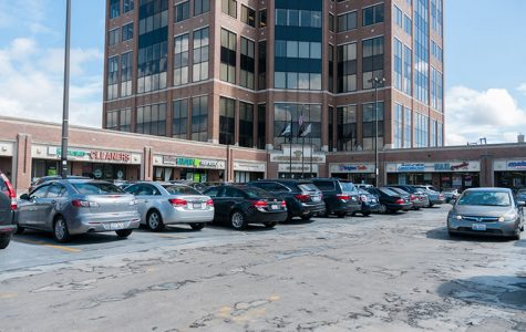 The parking lot in Veterans Plaza, next to the Jefferson Park Transit Center, is packed tightly without any extra parking spaces for cars.