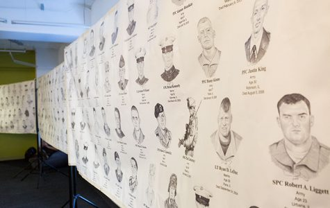 A display of Cameron Schilling's Portrait of a Soldier, on the 3rd floor of our library, 624 S. Michigan Ave. The piece is consists of hand-drawn portraits of 291 fallen soldiers from Illinois.