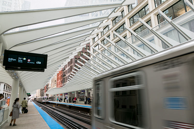 The newly-opened Washington/Wabash stop welcomes passengers with a skeletal top canopy.