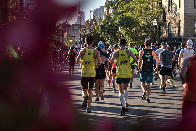 Participants run down Broadway Ave. in Lakeview on their route to the finish line. 2017 Bank of America Chicago Marathon, Sunday, Oct. 8.
