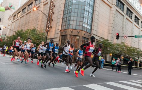 The men's elite group runs through River North at Grand and Wabash after the first mile marker during the 2017 Bank of America Chicago Marathon on Oct. 8.