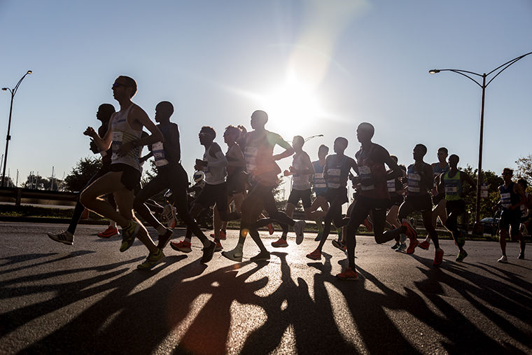 Participants run past the Belmont Harbor on Inner Lake Shore Drive early Sunday morning for the 2017 Bank of America Chicago Marathon, Sunday, Oct. 8.
