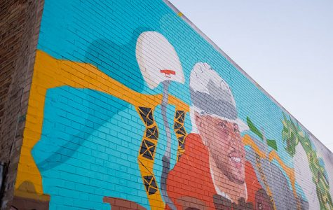 A work-in progress mural in Logan Square by artist Sam Kirk.