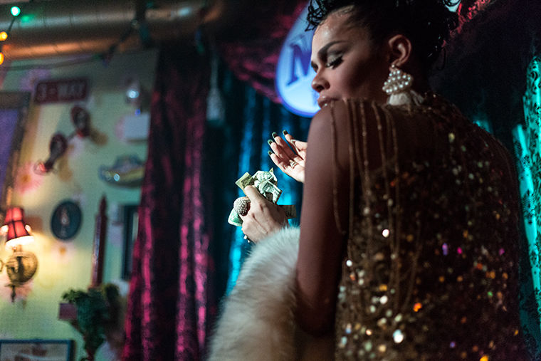 Monica Beverly Hillz, a contestant from season 5 of RuPaul's Drag Race, collects money during