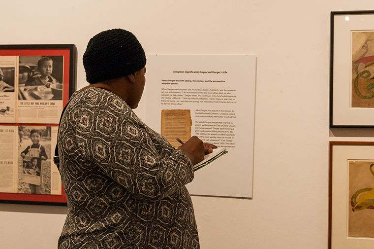 Poetry workshop participants walked around the gallery and wrote down words that jumped out to them from the artwork and descriptions around the gallery.
