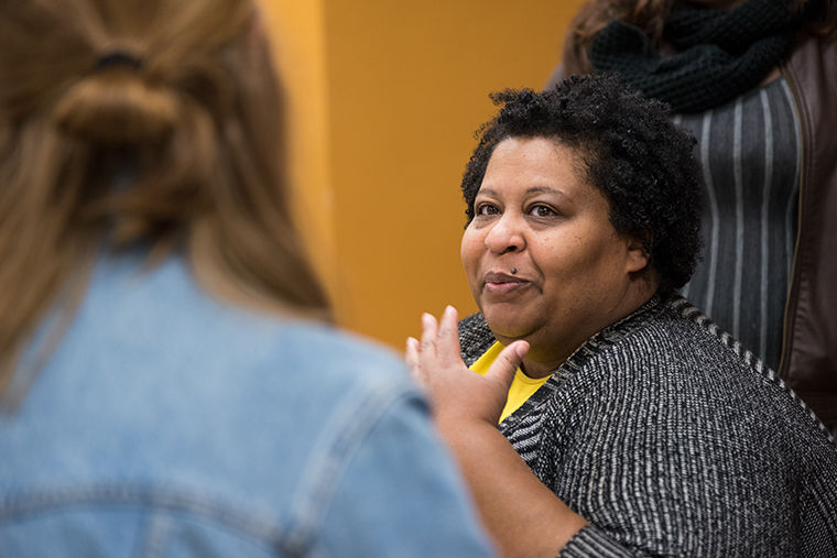 Comedian, Writer and Director Erica Watson working with senior design students at Columbia to do a complete re-design of her logo, merch and website. Photo taken during a class in 623 S. Wabash Ave. on Nov. 14.