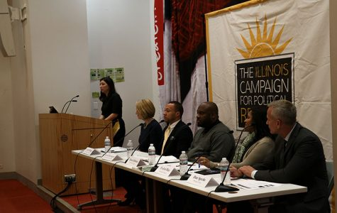 Leslie Munger, deputy governor of Illinois, Kevin Davenport, associate loan officer for the Chicago Neighborhood Initiatives, Jason Johnson, director of entrepreneurship for the Chicago Urban League, Evelyn Diaz, president of Heartland Alliance and Dan Sprehe, managing director of corporate responsibility for the Central Region at JPMorgan Chase & Co, spoke on the Inspiring Investment in Chicago Neighborhoods panel on Jan. 17 at Ferguson Hall, 600 S. Michigan Ave.