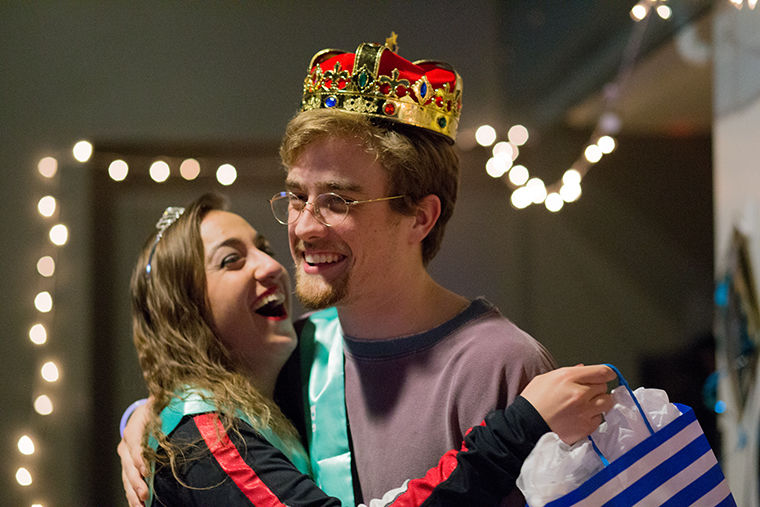 Jordan Gillespie and Jacob Schmidt hug after being announced as Blood Ball Queen and King at Dec'ed Out: A Dance Through the Decades Mar. 9 at the Conaway Center, 1104 S. Wabash Ave.