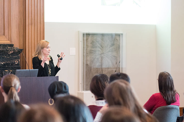 Emily Decker described superheroines and female comic book creators as a second-wave feminist movement at her March 5 lecture titled Unmasking the Myth of Superwoman.