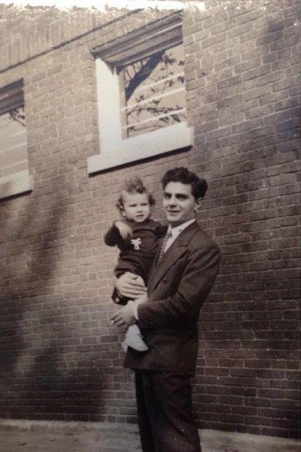 Olivia Deloian's great-grandfather Sam holding her grandfather, Dean Deloian.