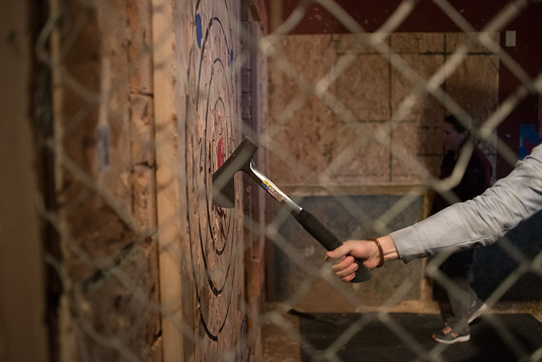 Bad Axe Throwing, 165 N Loomis St., hosts a corporate party for Cardno ChemRisk, an engineering consultant company, March 29.