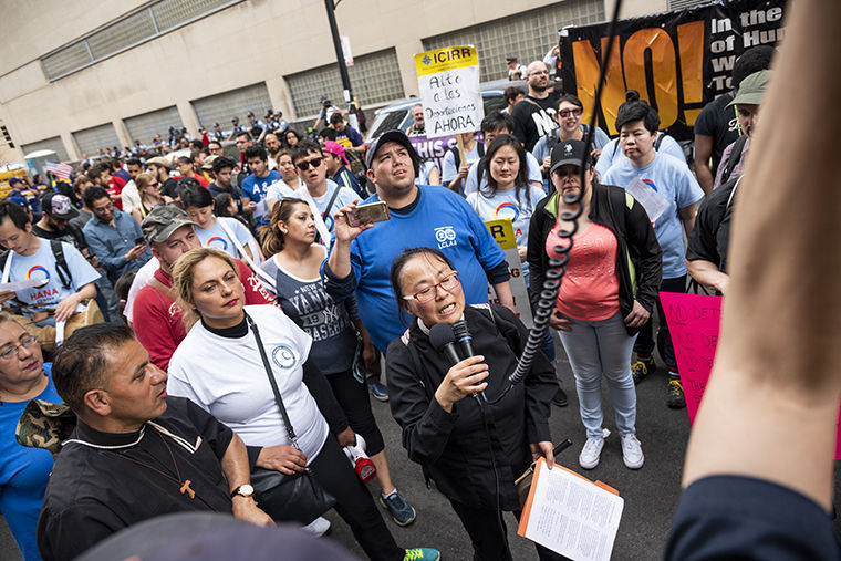 Organizing Director of HANA Center, Nayoung Ha, lead a prayer in English and Korean for a crowd of protesters on LaSalle Street and Congress Parkway.