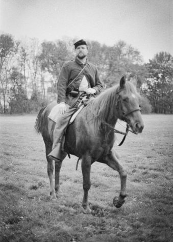 A reenactor rides a horse at the 2017 Neshaminy State Park Civil War Reenactment in Bensalem, Pennsylvania. Made with 35mm film, this image was part of a larger project documenting the annual event.
