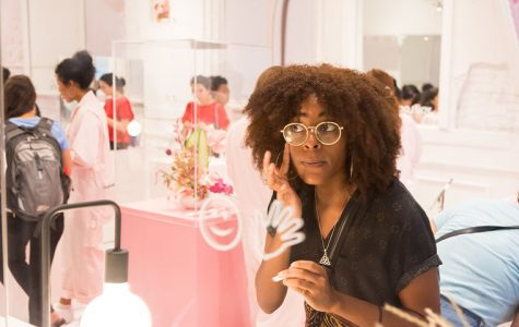 Desiree Jones of Woodlawn applies a product at the Glossier pop-up shop Aug. 28. Large mirrors and great lighting help customers when sampling the range of products offered by the New York City-based beauty brand.