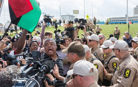 Rev. Gregory Livingston, leader of the O'Hare Shut-Down Protest, began singing to the crowd of activists before being peacefully arrested Sept. 3.