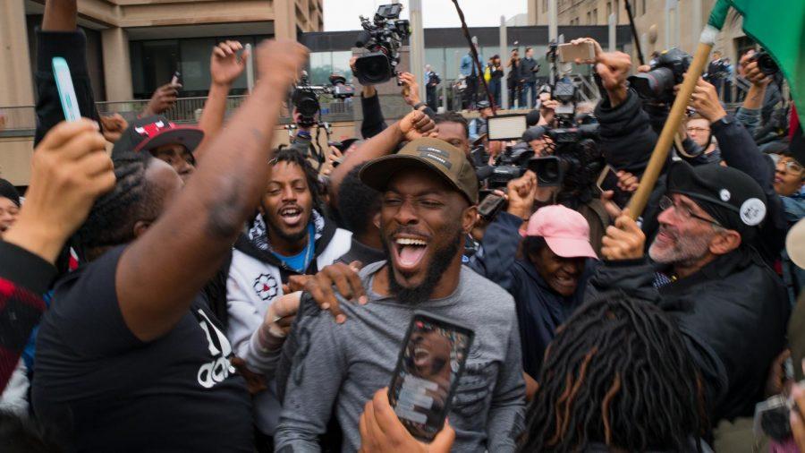 Activist Jedidiah Brown celebrates the verdict outside the Leighton Criminal Courthouse Oct. 5.