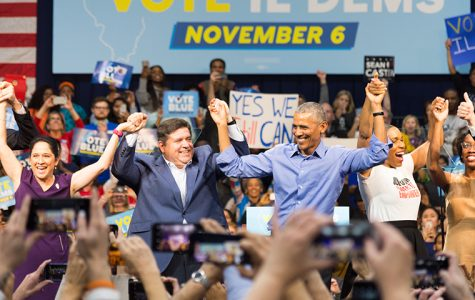 Illinois gubernatorial candidate JB Pritzker celebrates alongside former President Barack Obama at the