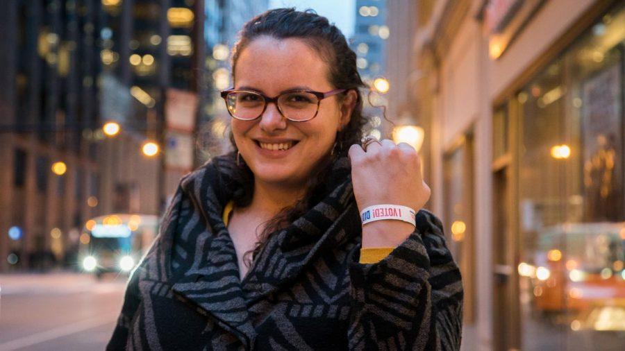 Morgan Rose shows off her bracelet after hitting the polls on voting day Nov. 6.