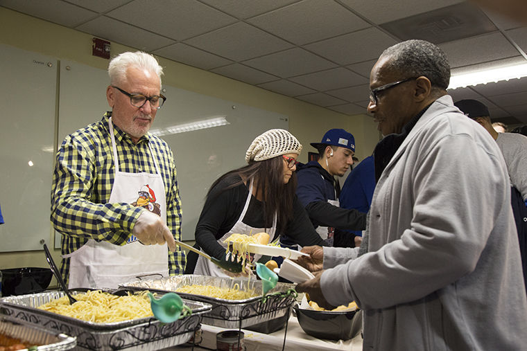Joe Maddon and his wife Jaye Maddon served guests during their annual Thankmas dinner at St. Leonard's Ministries, 2120 W. Warren Blvd, Jan. 17.
