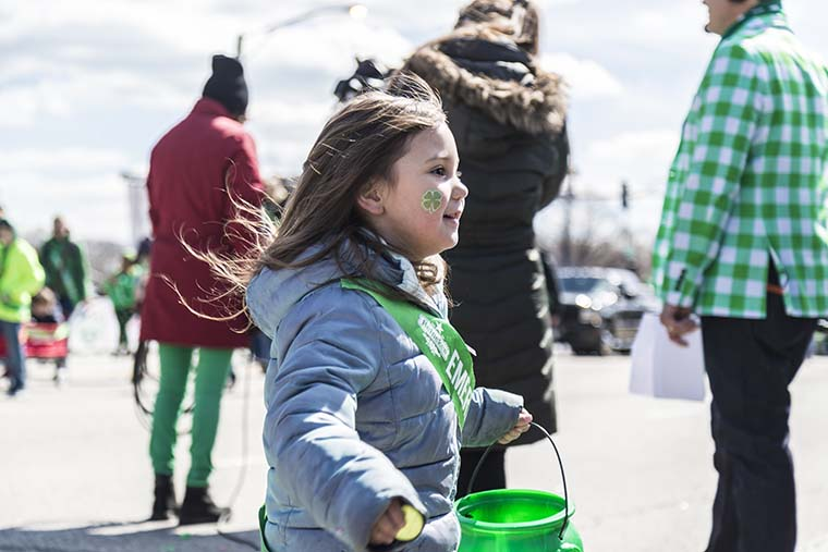 Parade+members+tossed+out+candy+and+waved+to+the+many+viewers+along+Columbus+Avenue.