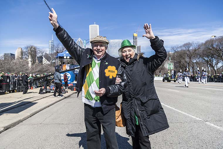 A+couple+shouts+in+excitement+to+celebrate++the+St.+Patricks+Day+parade+on+Saturday%2C+March+16.