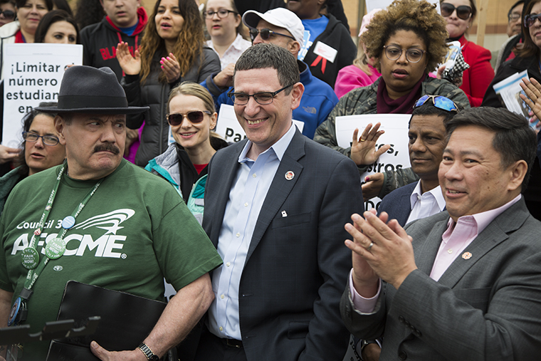 Jesse Sharkey, President of the Chicago's teachers union rallies with City College Chicago workers for a contract to,