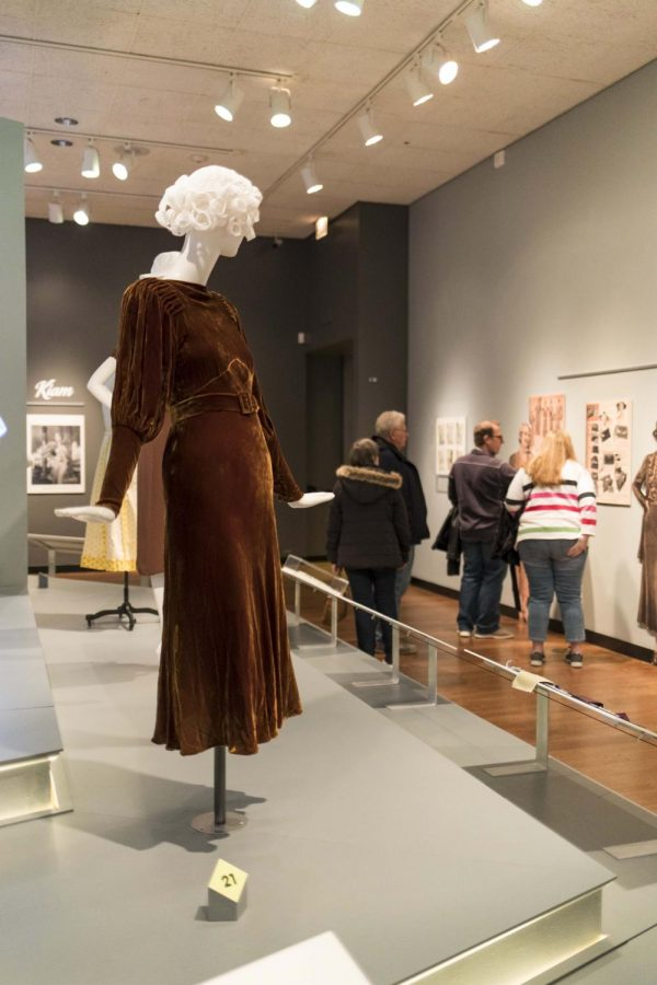The exhibit showcases how high-end fashion began to trickle down into household designs.