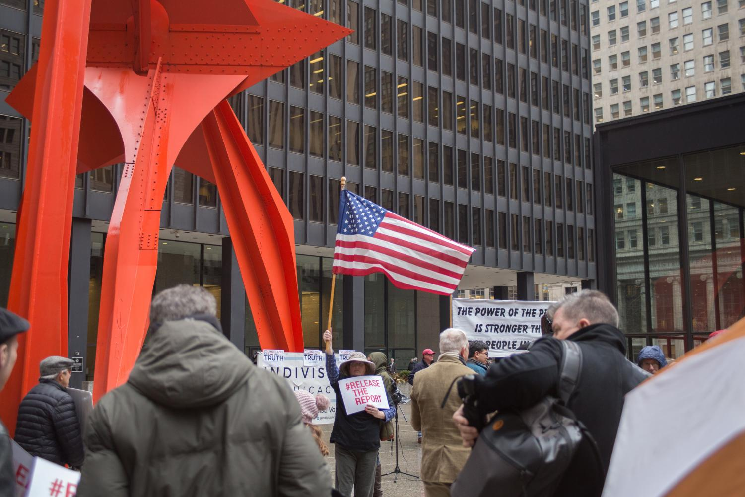Margaret+Hagerman+holds+the+United+States+flag+before+the+%23MakeItPublic+rally+began.