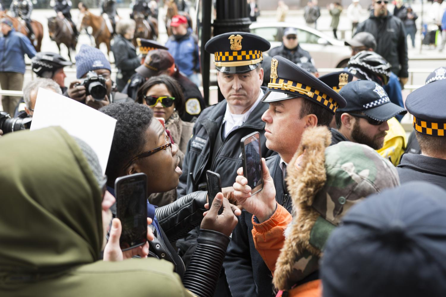 Ja%27Mal+Green+speaks+to+FOP+supporters+through+a+line+of+Chicago+Police+Officers+April+1.