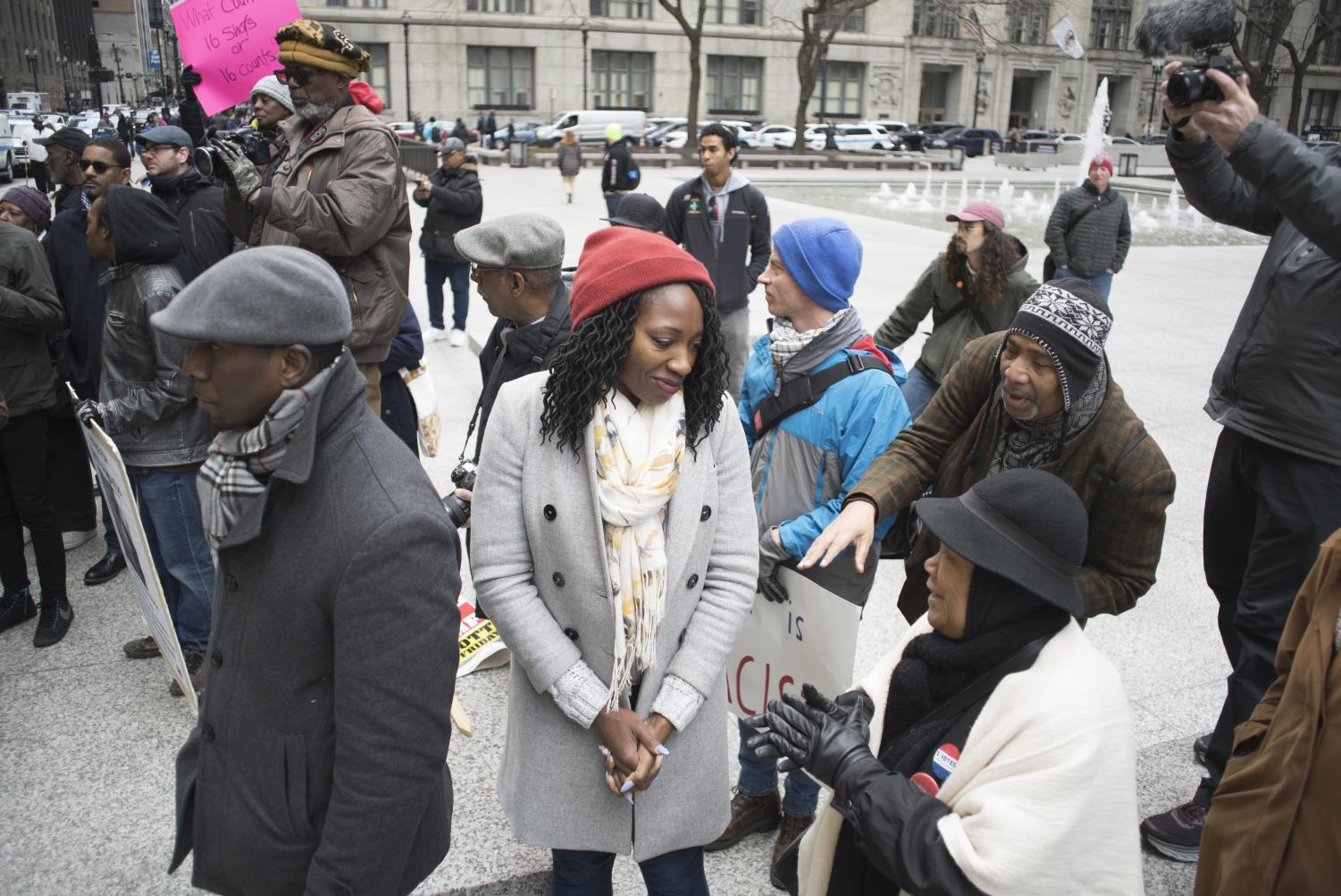 Community+organizer+Amara+Enyia+speaks+with+other+counter-protesters+April+1.