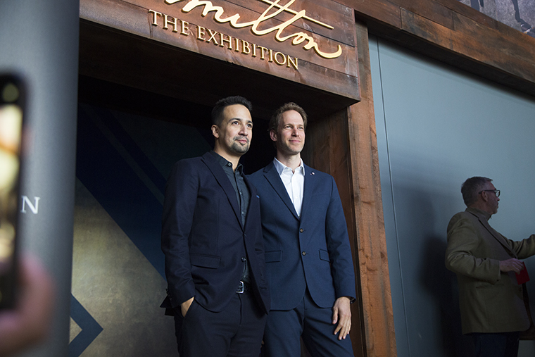 "Lin-Manuel Miranda and the exhibit's creative director, David Korins, attended a press conference and opening ceremony for ""Hamilton: The Exhibition"" April 26."