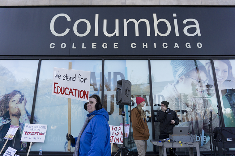 P-Fac members and students march along the sidewalk outside 600 S. Michigan Ave. Nov. 29 for the first day of the two-day P-Fac strike.