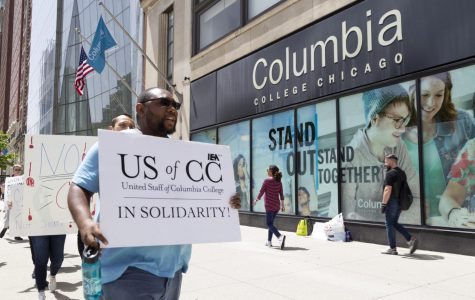 Staff members march in front of 600 S. Michigan Ave., where President and CEO Kwang-Wu Kim's office is located, after widespread staff layoffs during the summer.