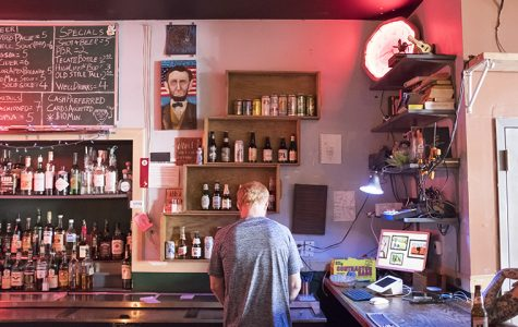 Bartender Jason Earl Folks behind the bar at Cole's Bar, 2338 N. Milwaukee Ave.