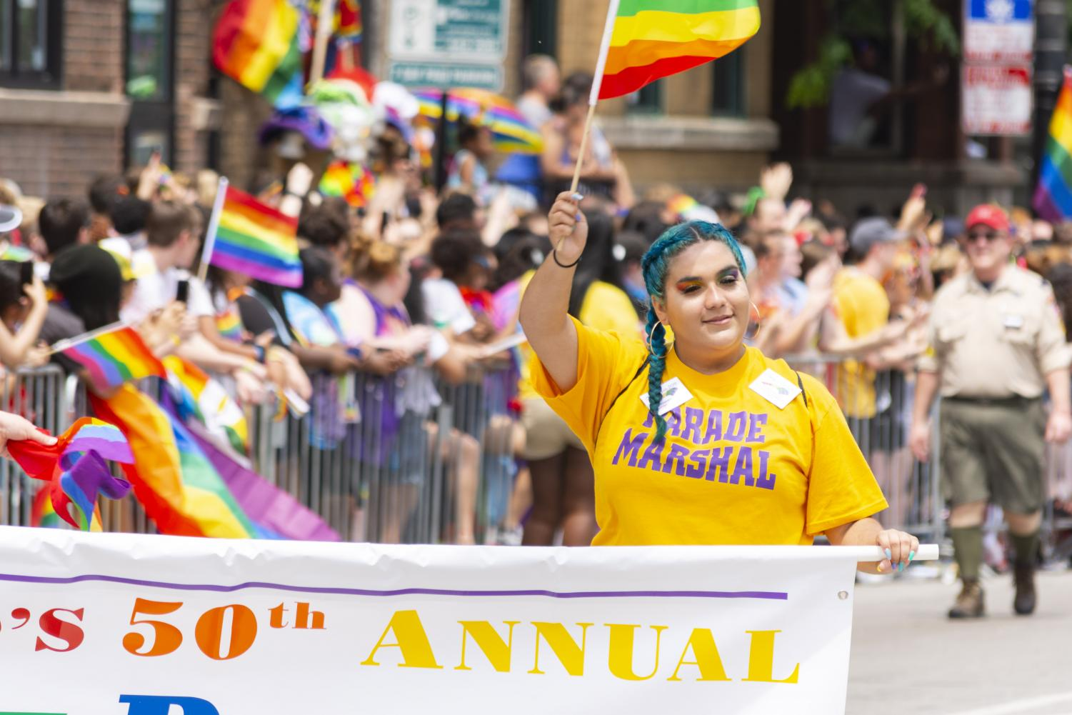 A+parade+marshal+waves+a+Pride+flag+while+carrying+the+banner+to+mark+the+beginning+of+Chicago%27s+50th+annual+Pride+Parade.