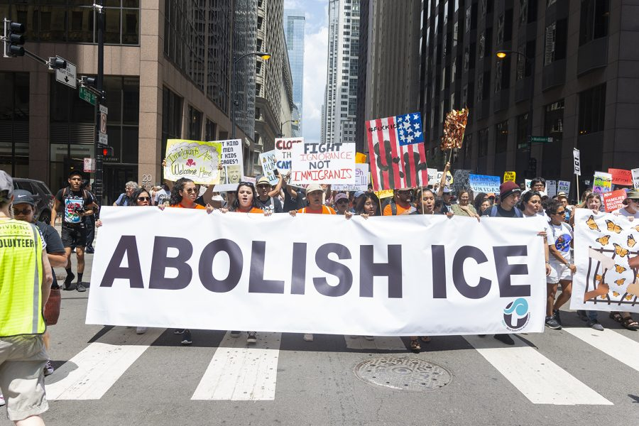 Thousands gather to protest ICE raids