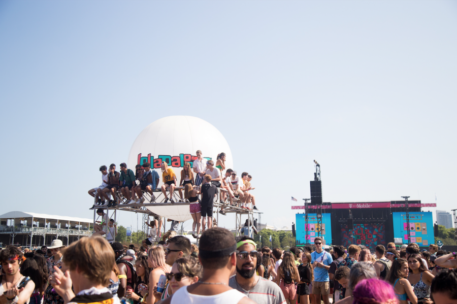Fans climb the Lollapalooza balloon stand to get a better view of the performers.
