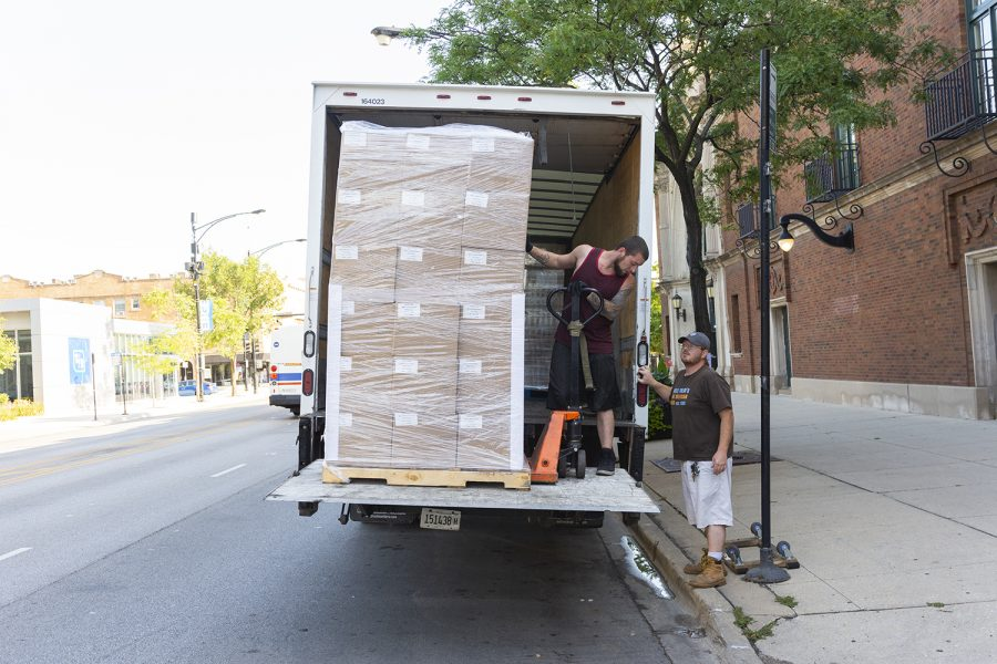 Volunteers+deliver+boxes+of+school+supplies+Aug.+8+to+Broadway+Armory%2C+5917+N.+Broadway.
