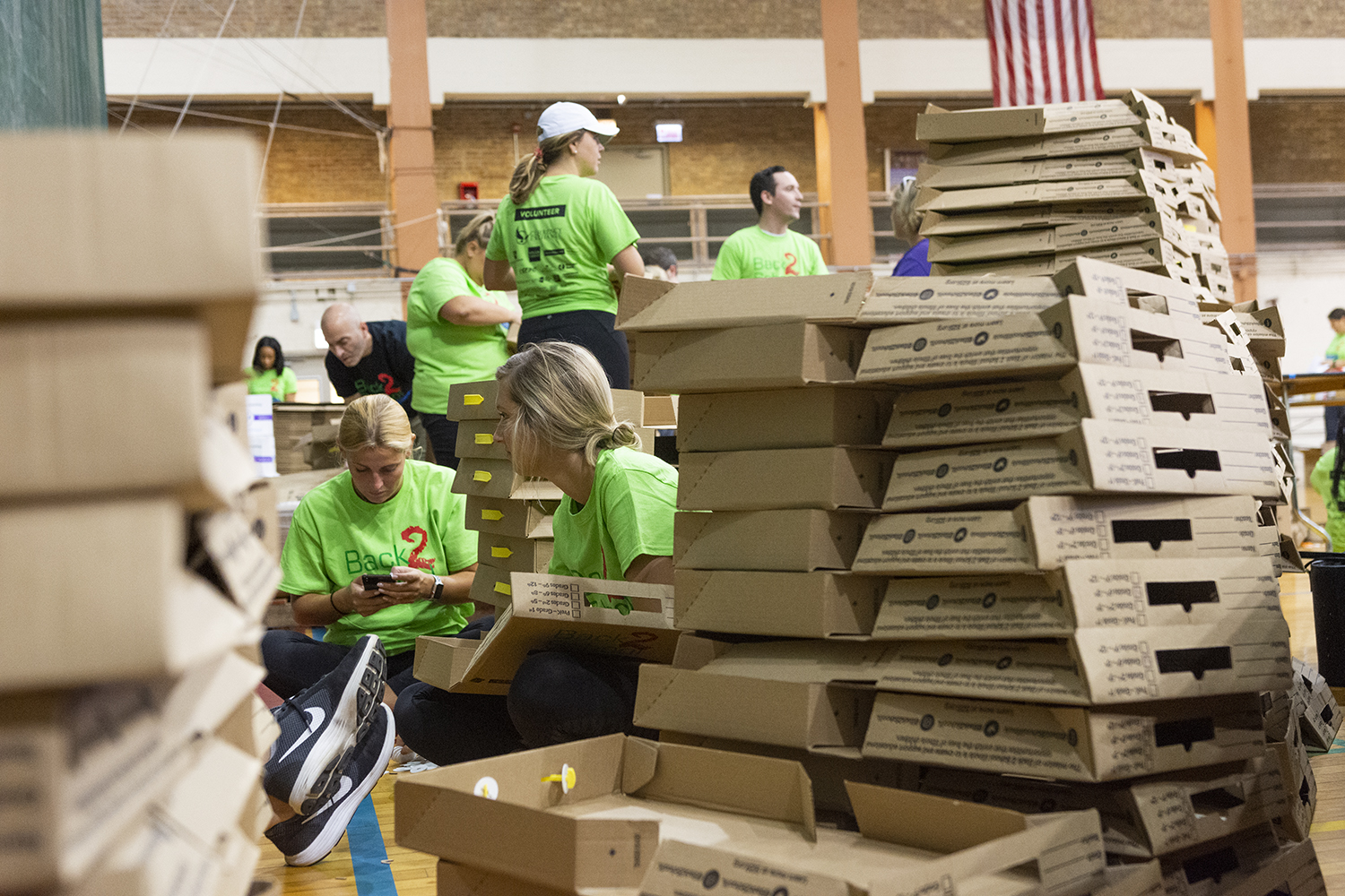 Volunteers+sit+among+boxes+waiting+to+be+filled+with+supplies+at+Broadway+Armory+Park%2C+5917+N.+Broadway%2C+Aug.+8.