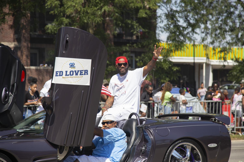 Radio+personality+Ed+Lover+rides+down+the+Bud+Billiken+Parade+path+atop+a+convertible.